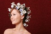 Woman with hair rollers on her hair
