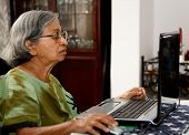 Asian Old Woman Using Computer