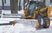 Tractor Clears Snow On City Streets