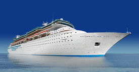 picture of cruise ship  - luxury white cruise ship shot at angle at water level on a clear day with calm seas and blue sky - JPG