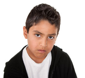 pic of spoiled brat  - Young hispanic boy with a serious attitude on a white background - JPG