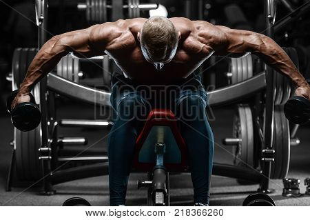 poster of blonde brutal sexy strong bodybuilder athletic fitness man pumping up abs muscles workout bodybuilding concept background - muscular handsome men doing health care fitness exercises in gym naked torso