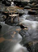 Long Exposure Rattan Chair At Waterfall.