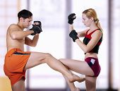 foto of martial arts girl  - Fight of young coupe - JPG