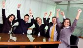 picture of business success  - business team at the office all celebrating their success  - JPG