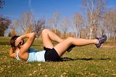stock photo of hottie  - Young woman doing a bicycle ab exercise - JPG