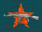 foto of ak 47  - grunge AK 47 and star on wall - JPG