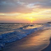 stock photo of beach sunset  - The beach at sunest in Panama City Beach Florida on the Florida Gulf Coast - JPG