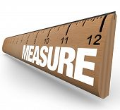 A wooden ruler with the word Measure, illustrating the need to do measurements to quantify objects o