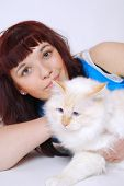 Teenage girl with Birman cat