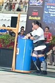 TOA PAYOH, SINGAPORE - MARCH 24 : Contender for Strongman Keith Wong in his 300kg yoke walk in the S