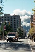 NEW YORK - SEPTEMBER 11: An ambulance moves away from the area known as Ground Zero after the collap