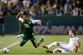 CARSON, CA. - April 23: Los Angeles Galaxy F Mike Magee #18 & Portland Timbers M Darlington Nagbe #6
