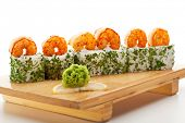 Japanese Cuisine - Sushi Roll with Cream Cheese inside. Topped with Shrimps and Dill outside