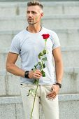 Little Romance Can Enhance Your Love Life. Man Mature Macho With Romantic Gift. Handsome Guy With Ro poster