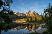 Sunrise At Stanley Lake In Idaho. Calm Water With Mountain Reflection poster