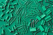 Green Paper Clips On A Green Background. Green Pin On A Green Background. School And Office Statione poster