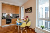 Light Spacious Studio Apartment. Served Table. Home Appliances. poster
