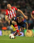 BARCELONA - MARCH, 31: Gaizka Toquero(L) of Athletic Bilbao vies with Dani Alves(R) of Barcelona dur