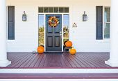Fall Decoration Adorns Beautiful Entry Way To Home. poster