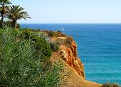 An Algarve Cliff The Cliffs Of The Algarve, Portugal Are Very Dramatic And Beautiful. poster