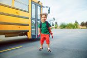Emotional Caucasian Boy Student Kid With Funny Face Expression Jumping Near Yellow Bus On 1 Septembe poster