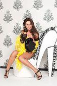 Glamoured portrait of fancy cabare dancer sits on high heel shoe