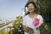 Smiling Woman Pruning Her Roses