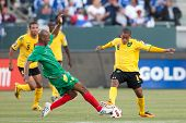 CARSON, CA. - JUNE 6: Grenada player D Leon Johnson #14 (L) & Jamaica player D Eric Vernan #8 (R) during the 2011 CONCACAF Gold Cup group B game on June 6 2011 at the Home Depot Center in Carson, CA.