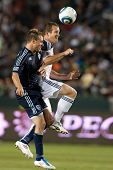 CARSON, CA. - MAY 14: Los Angeles Galaxy F Chad Barrett #11 (R) & Sporting Kansas City D Michael Har