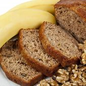 Fresh banana and walnut bread loaf, sliced.  Delicious healthy eating.