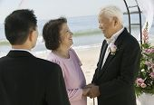 stock photo of early 60s  - Groom With Parents on Beach - JPG