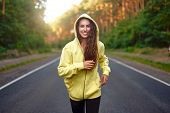 Close Up Portrait Curly Caucasian Young Girl Athlete Runs Sunny Summer Day On Asphalt Road In Pine F poster