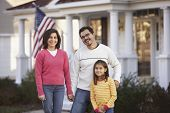 stock photo of tween  - Portrait of family in front yard - JPG