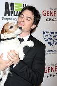 LOS ANGELES - MAR 24:  Ian Somerhalder, Uggie arrives at  the 2012 Genesis Awards at the Beverly Hilton Hotel on March 24, 2012 in Beverly Hills, CA
