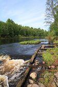 river flow on old destroyed dam