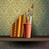 Different art brushes and pencils in flask.