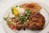 Mediterranean style chicken dinner with salad and rice