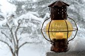 Vintage Lantern Against The Winter Garden