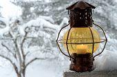 Vintage Lantern Against The Winter Garden
