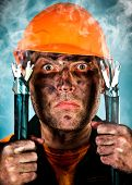 stock photo of teen smoking  - Electric shock sees a shocked electrician man - JPG