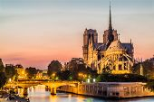 stock photo of notre dame  - notre dame de paris by night and the seine river France in the city of Paris in france - JPG