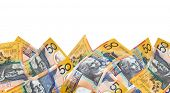 Border of Australian fifty dollar notes, over white background.