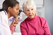 picture of otoscope  - Doctor Examining Senior Female Patient - JPG