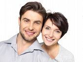 image of human beings  - Closeup portrait of beautiful happy couple isolated on white background - JPG