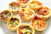 stock photo of crust  - Fresh baked mini quiches - JPG