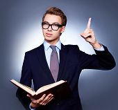 Nerdy-looking businessman urging everyone to read more and be as clever as him