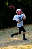 pic of little-league  - Young football player about to catch the football - JPG