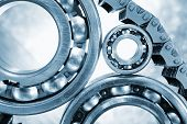 ball bearings, pinion-gears set against titanium, blue toning idea