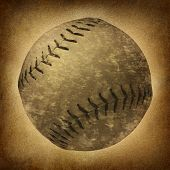stock photo of softball  - Old grunge baseball or softball as a vintage sports symbol on a dirty parchment background as an American cultural and traditional national pastime sport with a sphere made of leather and stitching - JPG